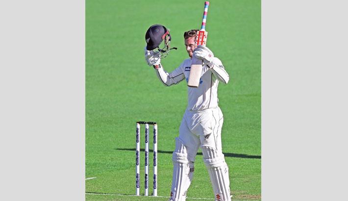 Nicholls' charmed ton puts NZ on top