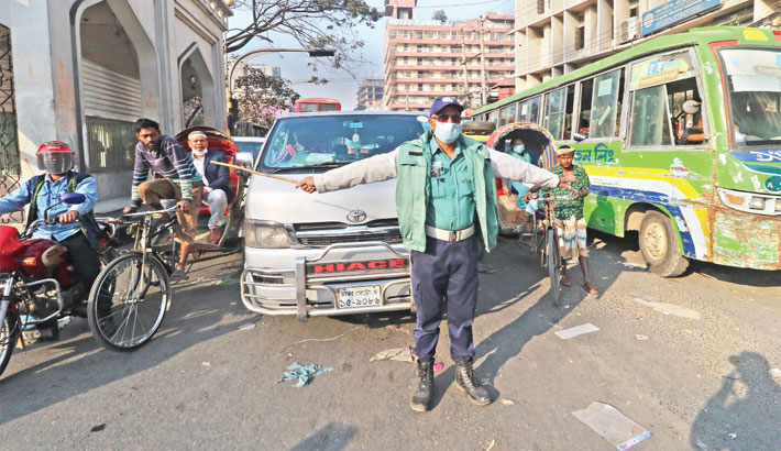 Dhaka traffic signal runs