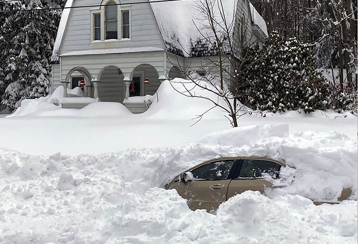 Motorist rescued after 10 hours in car buried by snow plow