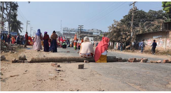 RMG workers block road demanding payment of dues in Gazipur