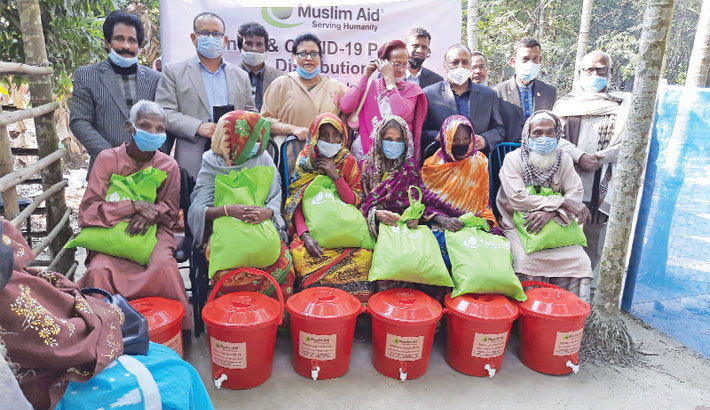 Recipients of winter clothes and Covid-19 hygiene and cleaning kits