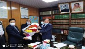 Law Minister exchanges New Year wishes with officials, staff members