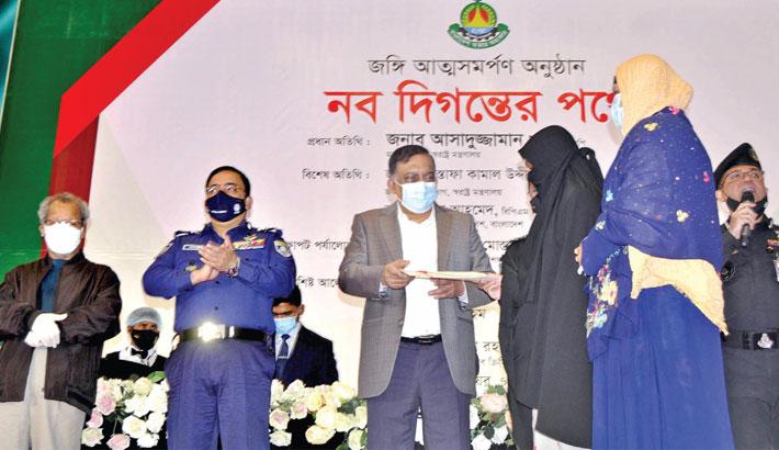 Home Minister Asaduzzaman Khan Kamal hands over a cheque
