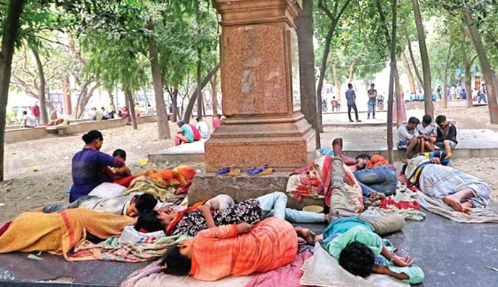 Addicts and vagabonds sleep inside the historic Bahadur Shah Park in Old Dhaka