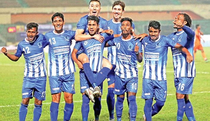 Players of Sheikh Russel KC Ltd celebrate after scoring a goal