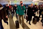 Police detain Kremlin critic Navalny on arrival in Russia