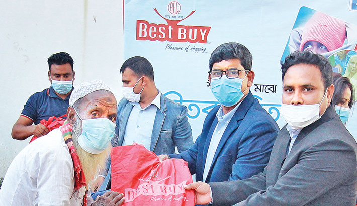 Best Buy gives warm clothes to cold-hit people in Rangpur