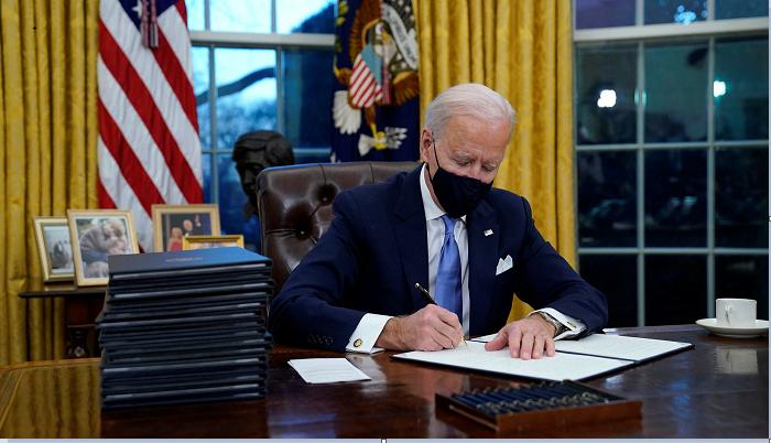 Biden signs executive order rejoining Paris climate agreement