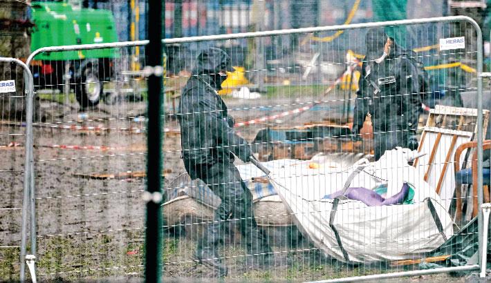 Security officials dismantle a camp