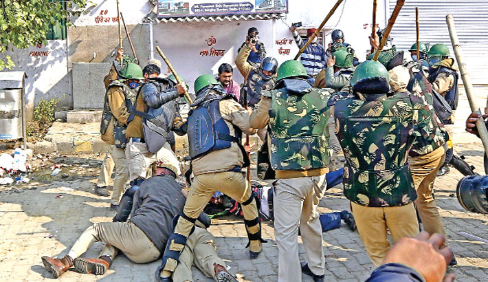 Police beat a farmer as they continue to protest