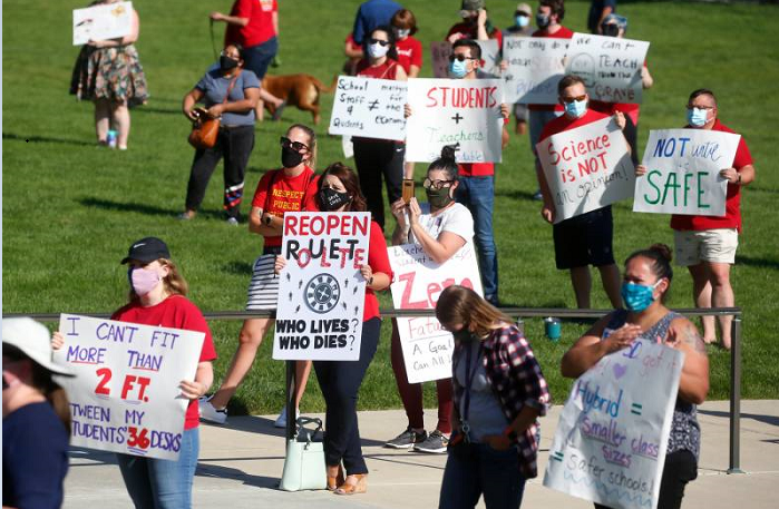 US in tug-of-war with teachers over reopening schools