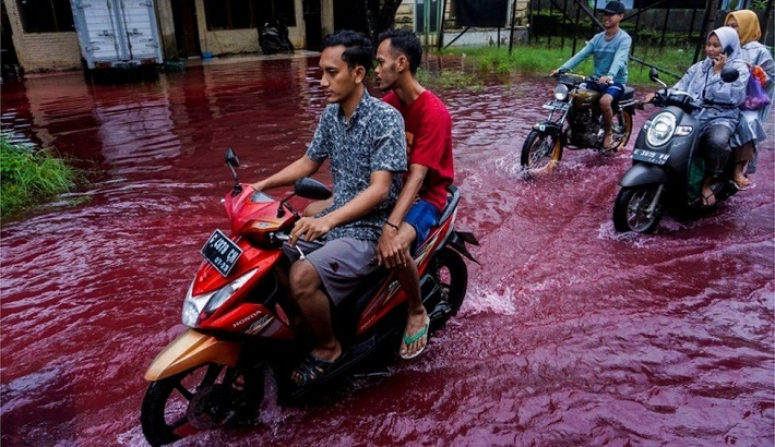 Indonesia village submerged by red water after flood hits batik factory
