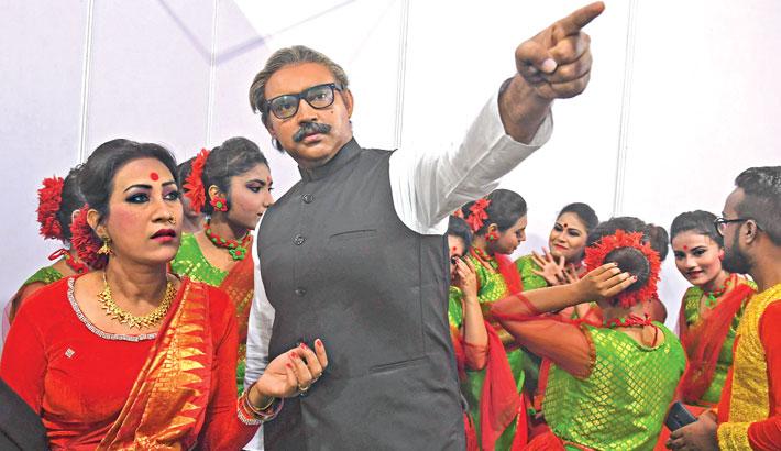 An artiste dressed as Bangladesh's founder Bangabandhu Sheikh Mujibur Rahman