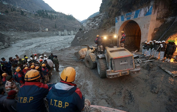 India glacier disaster leaves 26 dead, workers hunt for survivors