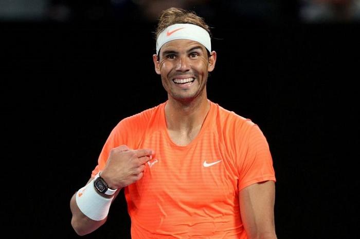 Rowdy fan kicked out as Nadal powers on in Australia