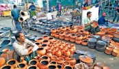Traders put on display traditional clay pots for sale