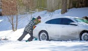 Arctic air, winter storms grip much of US