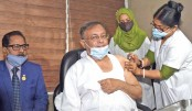Dr Hasan Mahmud receives Covid-19 vaccine administered by a nurse at the Secretariat Clinic