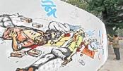 An artist paints graffiti commemorating the Language Movement