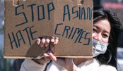 A sign takes part in a rally to raise awareness