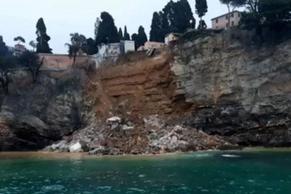 Italian landslide sends 200 coffins into sea