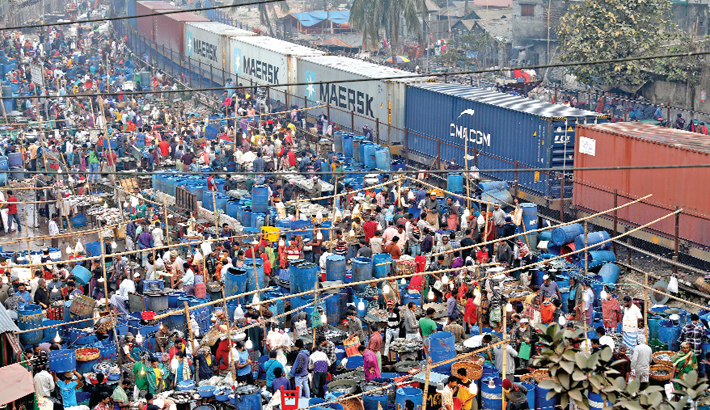 A makeshift fish market has been set up beside railway lines