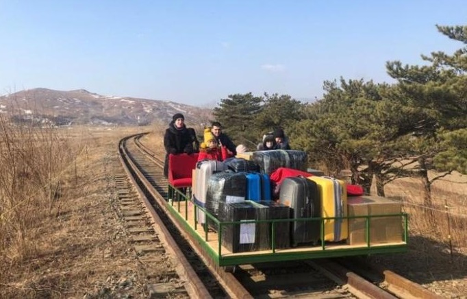 Russian diplomats and their families leave North Korea by hand-pushed rail trolley