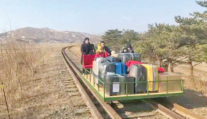 Russian diplomats arrive home from North Korea on rail trolley