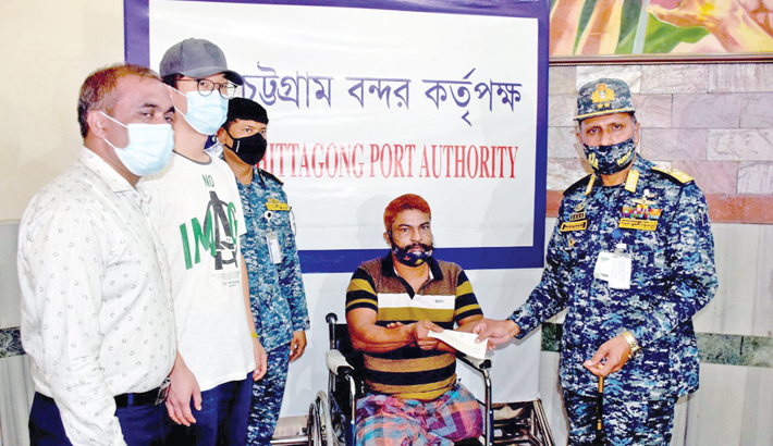 Hands over a donation cheque