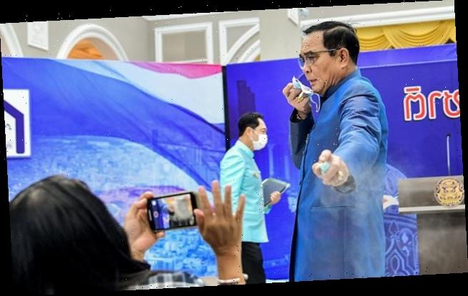 Thai PM sprays reporters with hand sanitiser to avoid tough question