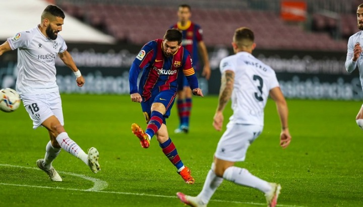 Messi celebrates levelling Xavi record with double against Huesca