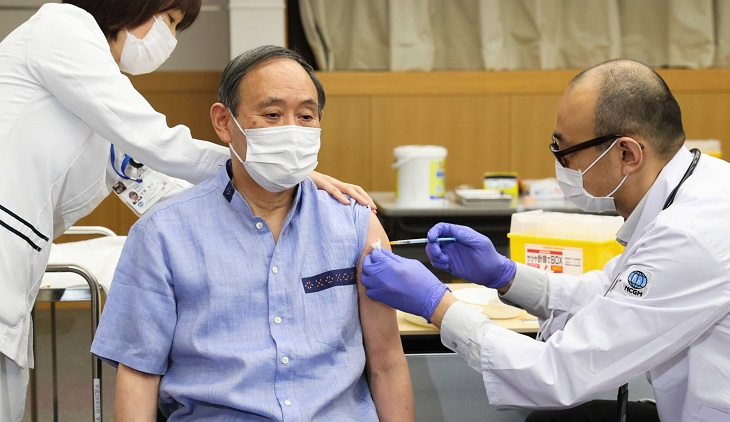 Japan's PM receives 1st dose of Pfizer vaccine