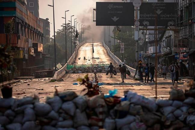 Town a battle zone as Myanmar junta enforces martial law