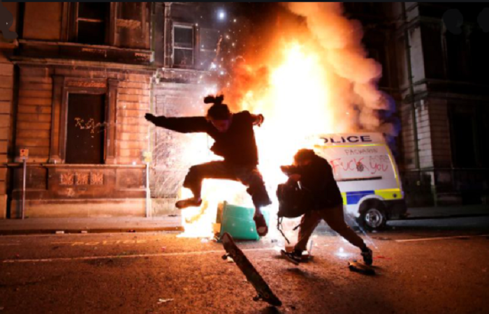 Protesters injure police and set vehicles ablaze in Bristol