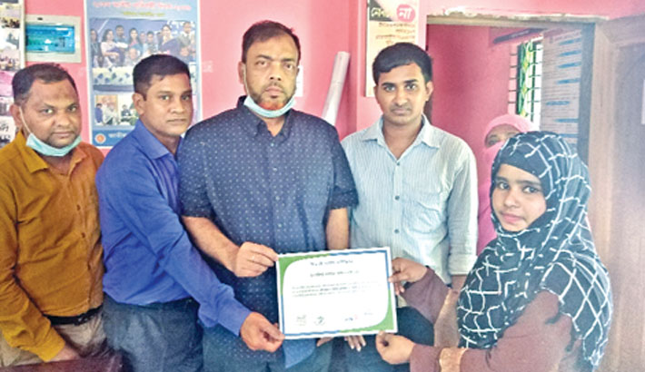 Physically handicapped Rumi Akter receives a certificate