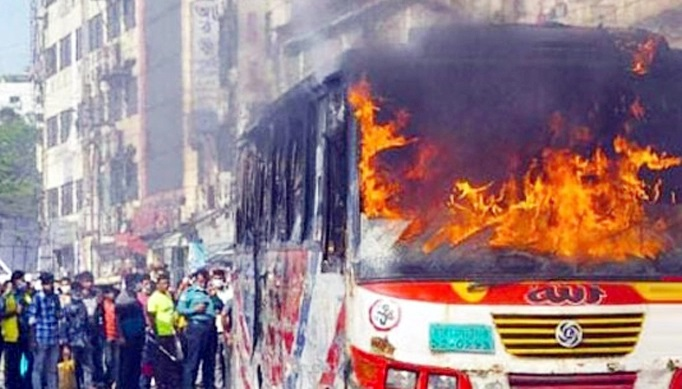 Passenger bus set on fire in Malibagh