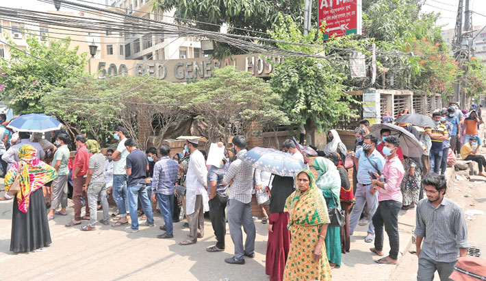 People wait in long queues for Covid-19 test