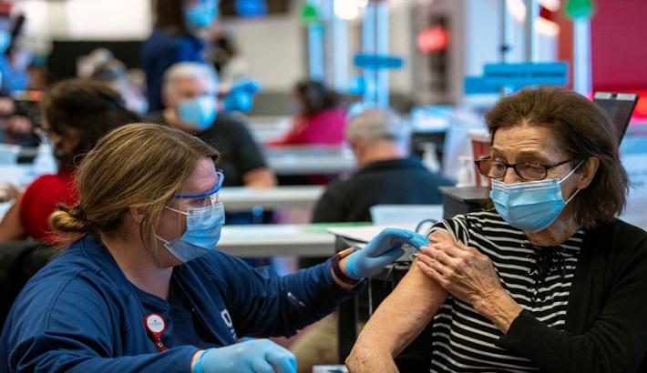 Biden ramps up Covid-19 vaccinations but warns 'war far from won'