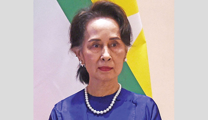 Suu Kyi charged with official secrets violation