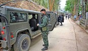 Thai army soldiers gather at a checkpoint in Mae Sam Laep town on