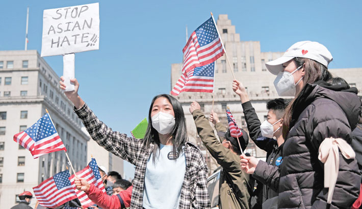 Police, communities across US fight back against anti-Asian hate crimes