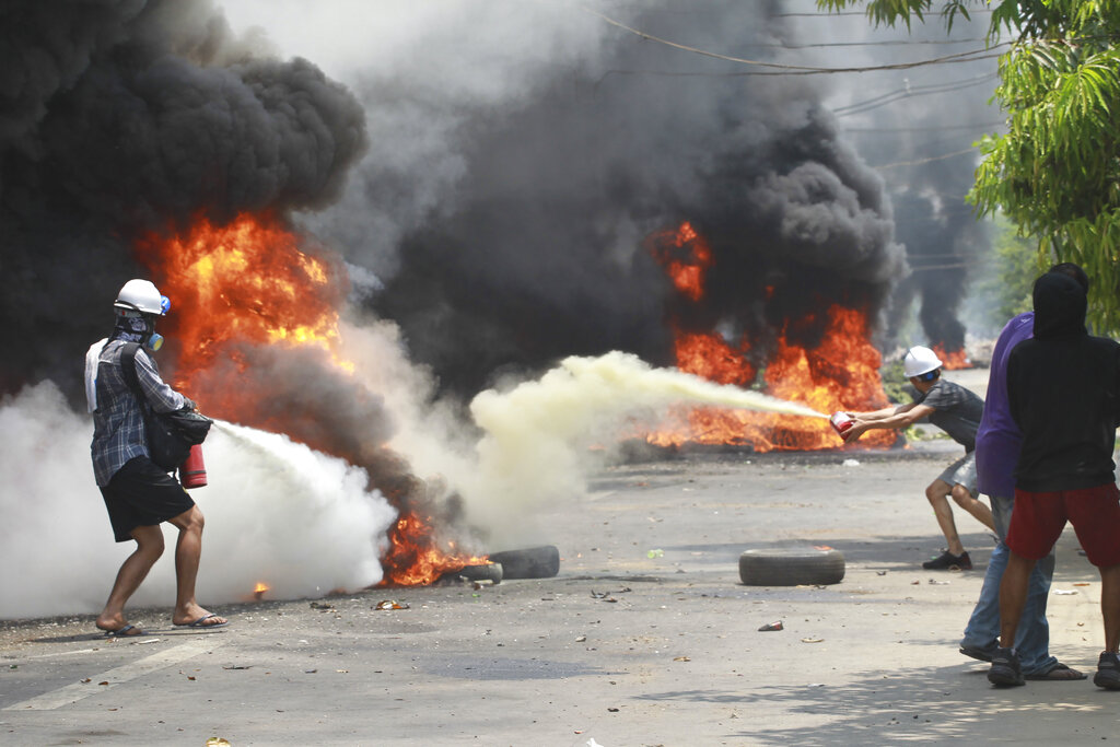 Myanmar security forces kill 13 protesters; small blasts hit Yangon