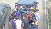 People on a pick-up leave Dhaka for their village homes