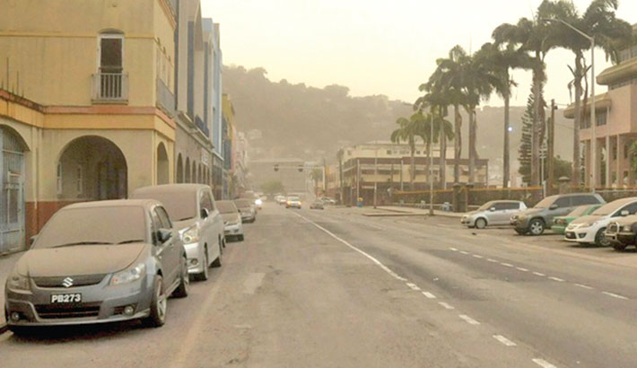 Ash covers roads a day after the La Soufriere volcano erupted after decades of inactivity