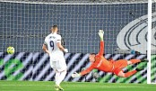Real edge thrilling Clasico to go top of La Liga