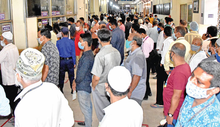 Clients throng the Motijheel branch of Sonali Bank to draw money