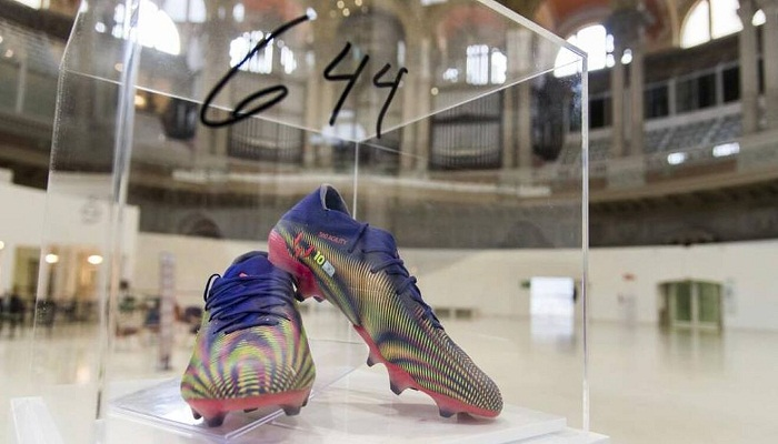 Lionel Messi's record-breaking boots to be auctioned for charity