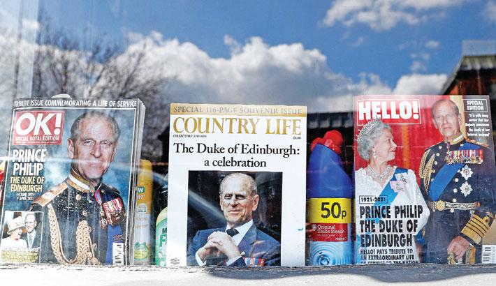 Magazines featuring Britain's Queen Elizabeth II and Britain's Prince Philip