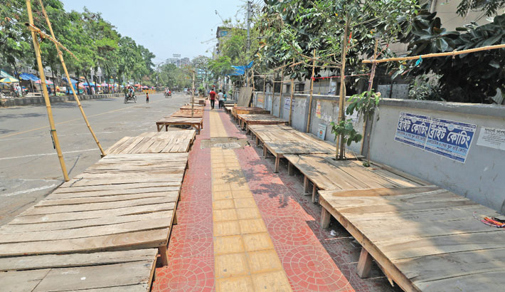 Wooden structures on the footpath which vendors use to sell various things now lie empty during