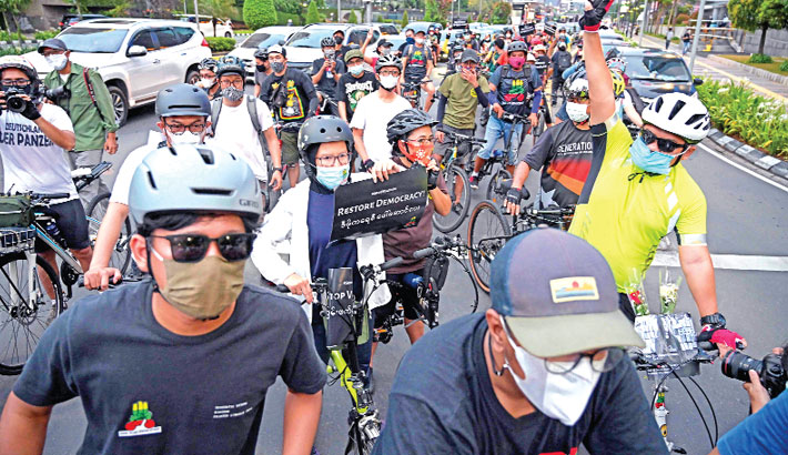 Indonesian cyclists take part in a rally to show their support for democracy